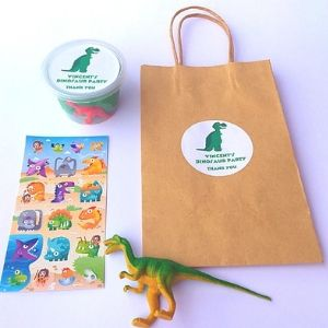 Dinosaur Party Bag with dinosaur stickers, play dough and plastic dinosaur