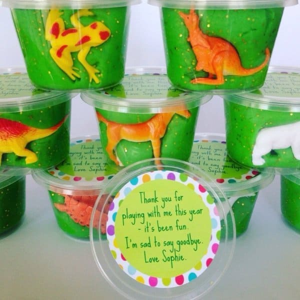 Play Dough Party Favors Green play dough tubs with plastic animals