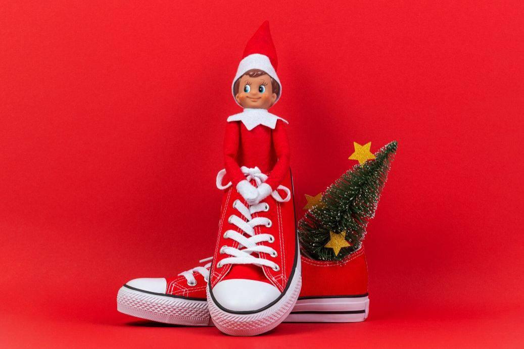Elf on the Shelf hiding in a shoe